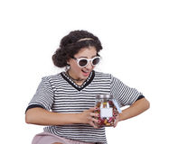 Young woman with a jar of candies. Image of a young woman with a jar of candies posing against white background Stock Image
