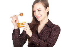 Young woman with jar of honey Royalty Free Stock Photography