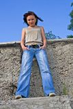 Young woman in jeans Royalty Free Stock Image