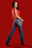Young woman in jeans Stock Photography