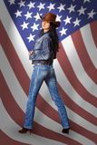 Young woman in jeans with American flag Stock Photos