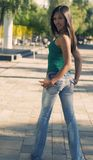 Young Woman in Jeans backside. Attractive Young Woman wearing cool tight denim jeans. This image is styled in the cross process style royalty free stock photo