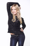 Young woman in jeans and black sweater Royalty Free Stock Images