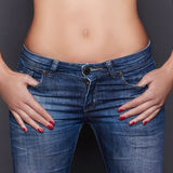 Young woman in jeans clothes. Young woman in jeans with beautiful belly Royalty Free Stock Image