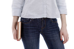 Young woman in jeans holding book Royalty Free Stock Image