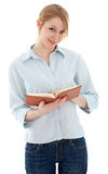 Young woman in jeans holding book Royalty Free Stock Photography