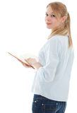 Young woman in jeans holding book Royalty Free Stock Images