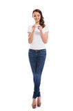 A young woman in jeans holding a phone Royalty Free Stock Images