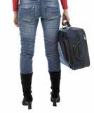 Young woman in jeans holding suitcase Stock Image