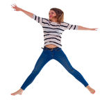 Young woman in jeans jumping Royalty Free Stock Photo