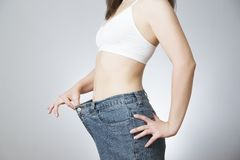 Young woman in jeans of large size, concept of weight loss Royalty Free Stock Images