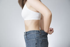 Young woman in jeans of large size, concept of weight loss Royalty Free Stock Photography