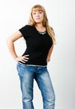 Young woman in jeans with long hair Royalty Free Stock Image