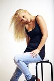 Young Woman in Jeans in a Seductive Pose Stock Images