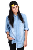 Young woman in jeans shirt and cap posing stock photography