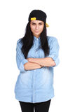 Young woman in jeans shirt and cap posing royalty free stock photos
