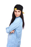 Young woman in jeans shirt and cap posing stock photo