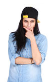 Young woman in jeans shirt and cap posing stock photos