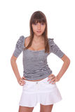 Young woman in jeans shorts Royalty Free Stock Image