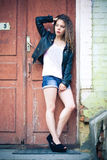 Young woman in jeans shorts and leather jacket Stock Photos