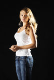 Young woman in jeans sideview Stock Photography