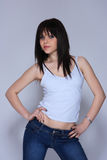 Young woman in jeans and t shirt Stock Images