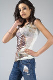 Young woman in jeans and white shirt Royalty Free Stock Photography