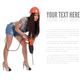 Young woman in jeans witch electric hammer drill.Isolated. Stock Photos