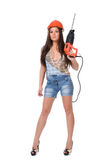 Young woman in jeans witch electric hammer drill.Isolated. Stock Photo