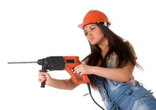 Young woman in jeans witch electric hammer drill Royalty Free Stock Image