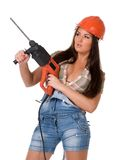 Young woman in jeans witch electric hammer drill Royalty Free Stock Photos