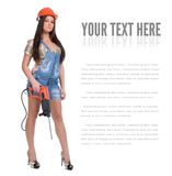 Young woman in jeans witch electric hammer drill Stock Photos