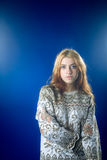 Young woman in jersey on blue background Royalty Free Stock Images
