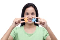 Young woman with jigsaw puzzle Stock Images