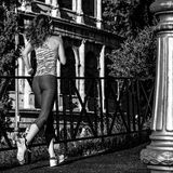 Young woman jogger near Colosseum in Rome, Italy running Royalty Free Stock Images
