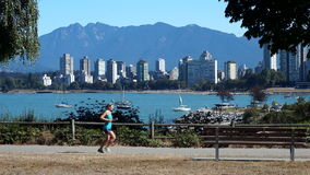 Young woman jogger in Vancouver stock video