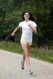 Young woman jogging Royalty Free Stock Photography