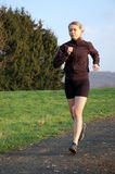 Young Woman Jogging. A Young Woman Jogging Outdoors stock photos