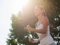 Young woman jogging Royalty Free Stock Photos