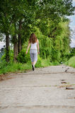 Young woman jogging alongside Stock Photo