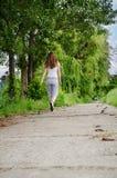 Young woman jogging alongside Stock Photo