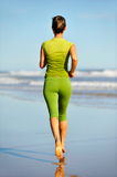 Young woman jogging on the beach Royalty Free Stock Image
