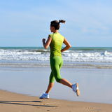 Young woman jogging on the beach Stock Photos