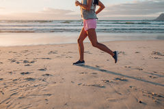 Young woman jogging on the beach Stock Image