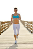 Young woman jogging on the beach Stock Photography