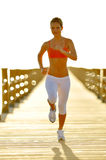 Young woman jogging on the beach Royalty Free Stock Photo