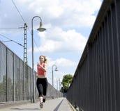 Young woman jogging Stock Photos