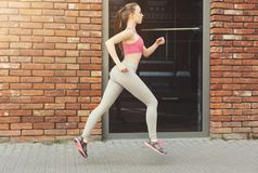 Young woman jogging in city copy space stock photos
