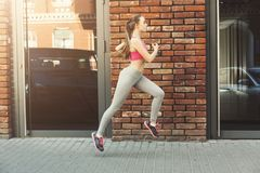 Young woman jogging in city copy space royalty free stock photography