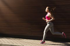 Young woman jogging in city copy space royalty free stock photo